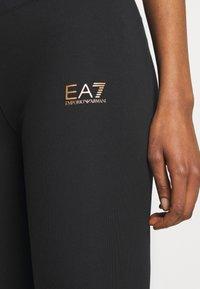 EA7 Emporio Armani - Leggings - black/gold - 5