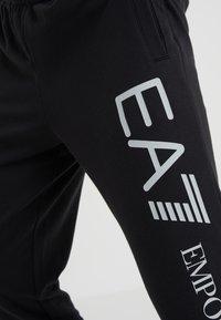 EA7 Emporio Armani - PANTALONI - Teplákové kalhoty - black - 4