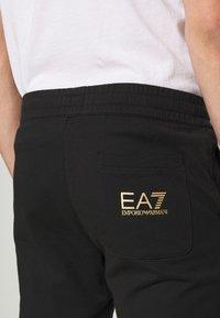 EA7 Emporio Armani - PANTALONI - Teplákové kalhoty - black - 5