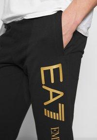 EA7 Emporio Armani - PANTALONI - Teplákové kalhoty - black - 3