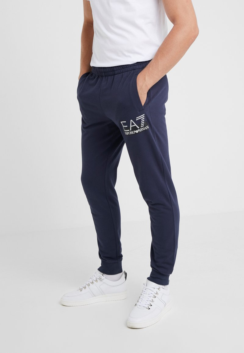 EA7 Emporio Armani - TROUSER - Tracksuit bottoms - blue