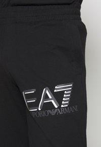 EA7 Emporio Armani - PANTALONI - Træningsbukser - black - 4