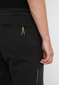 EA7 Emporio Armani - Pantalones deportivos - black / neon / yellow - 3