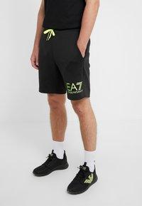 EA7 Emporio Armani - Pantalones deportivos - black / neon / yellow - 0