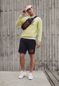 EA7 Emporio Armani - Tracksuit bottoms - black/neon/orange - 4