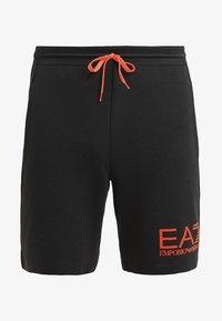 EA7 Emporio Armani - Tracksuit bottoms - black/neon/orange - 5