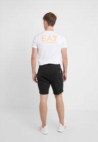 EA7 Emporio Armani - Tracksuit bottoms - black/neon/orange - 2