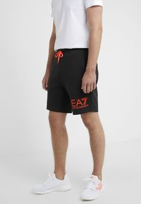 EA7 Emporio Armani - Tracksuit bottoms - black/neon/orange - 0