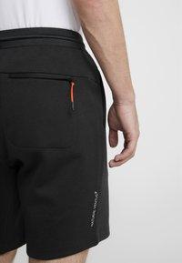 EA7 Emporio Armani - Tracksuit bottoms - black/neon/orange - 3