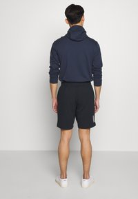 EA7 Emporio Armani - BERMUDA - Tracksuit bottoms - night blue - 2