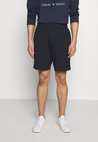EA7 Emporio Armani - BERMUDA - Tracksuit bottoms - night blue - 0