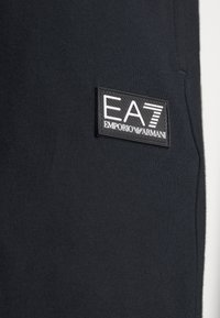 EA7 Emporio Armani - BERMUDA - Tracksuit bottoms - night blue - 3