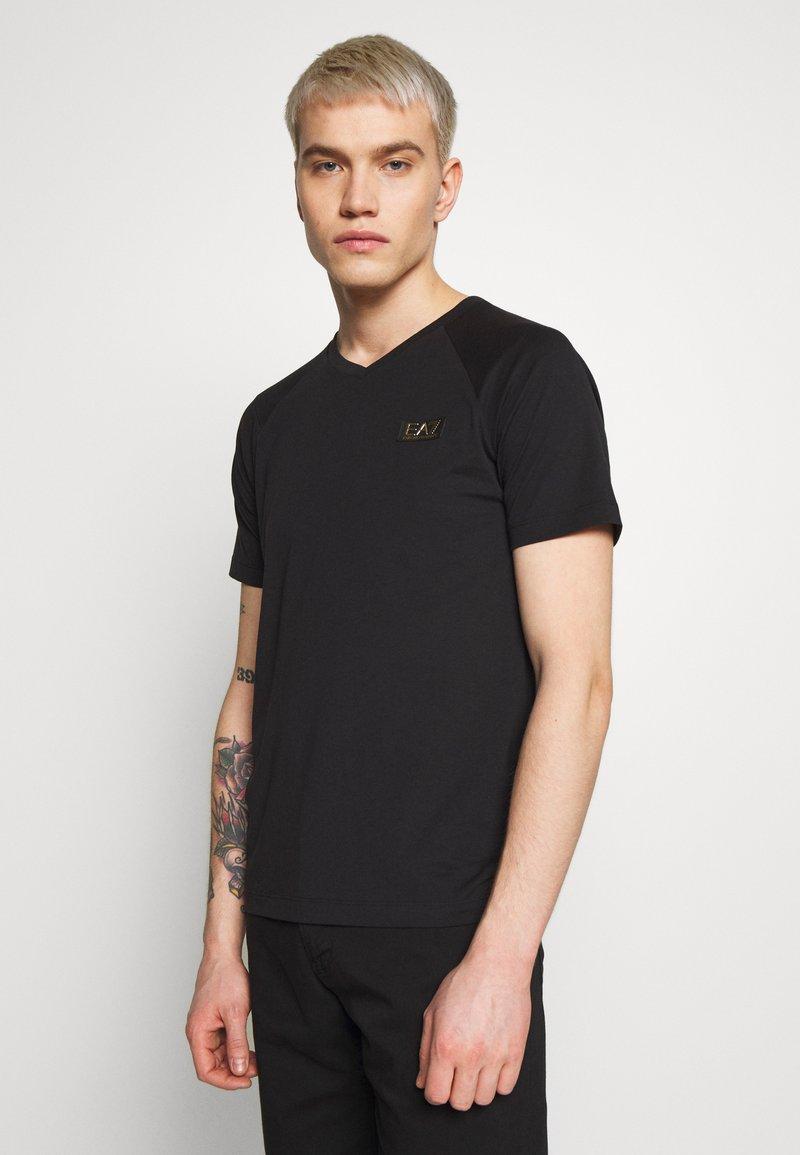 EA7 Emporio Armani - T-shirt imprimé - black