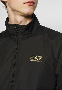 EA7 Emporio Armani - GIUBBOTTO - Chaqueta fina - black - 5