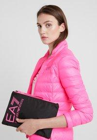 EA7 Emporio Armani - CLUTCH BAG NEON - Clutch - black / neon pink - 1