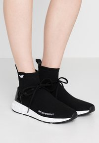 Emporio Armani - High-top trainers - black - 0