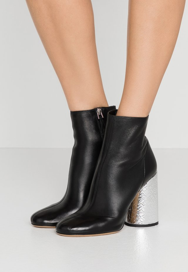 High heeled ankle boots - black/silver