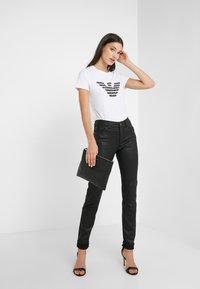Emporio Armani - Jeans Skinny Fit - nero - 1