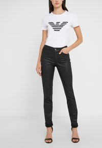 Emporio Armani - Jeans Skinny Fit - nero - 0