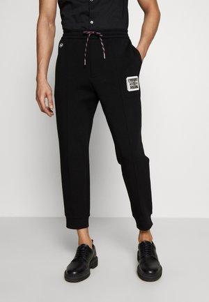 PANTALONI TESSUTO - Spodnie treningowe - black