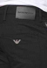 Emporio Armani - TESSUTO - Trousers - nero - 5