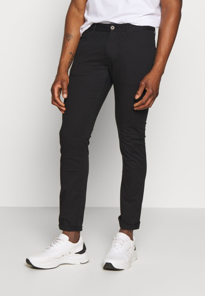 Emporio Armani - TESSUTO - Trousers - nero