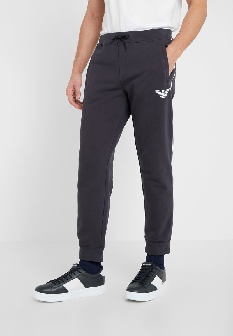 Emporio Armani - TROUSERS - Tracksuit bottoms - navy blue