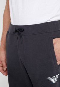 Emporio Armani - TROUSERS - Tracksuit bottoms - navy blue - 6