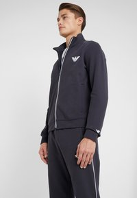 Emporio Armani - TROUSERS - Tracksuit bottoms - navy blue - 3