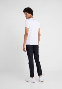 Emporio Armani - T-shirt med print - bianco ottico - 2