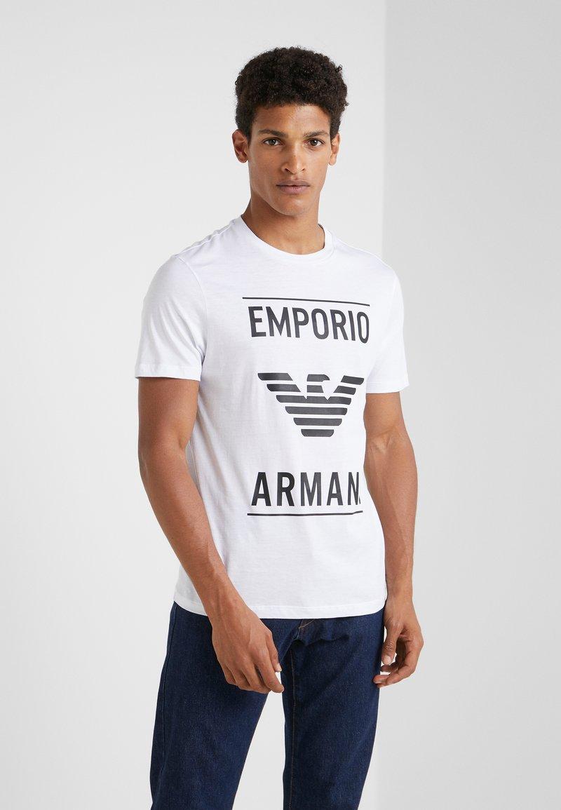 Emporio Armani - T-shirts med print - bianco ottico