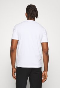 Emporio Armani - T-shirt imprimé - bianco ottico - 2