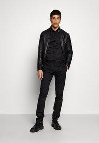 Emporio Armani - CABAN - Leather jacket - black - 1
