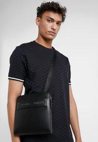 Emporio Armani - FLAT MESSENGER BAG - Across body bag - black - 1