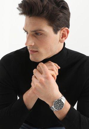 Horloge - silberfarben