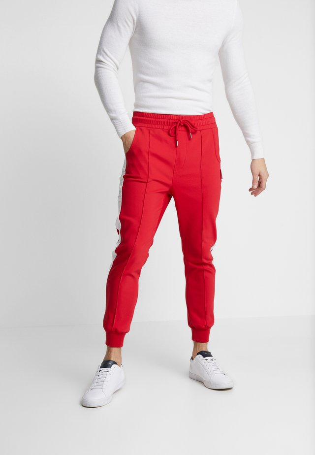 DOMINIK - Trousers - red