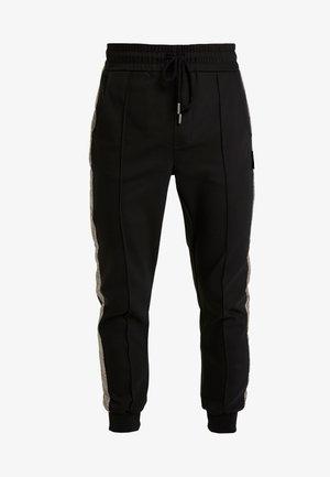 DOMINIK - Spodnie materiałowe - black