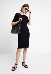 edc by Esprit - BELTED DRESS - Jerseykjole - black - 2