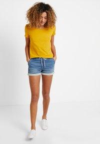 edc by Esprit - OCS BACK DETAIL - Print T-shirt - honey yellow - 1