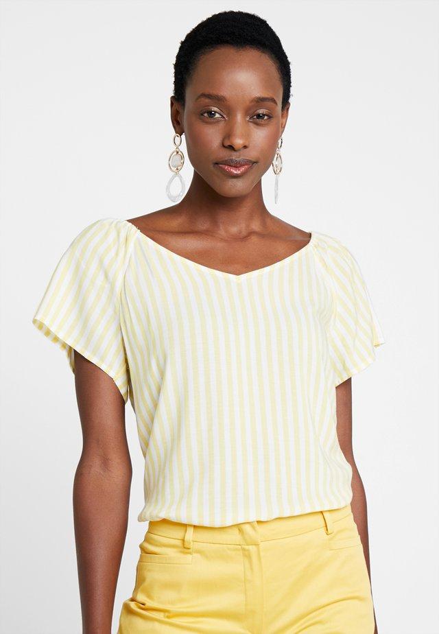 Blusa - light yellow