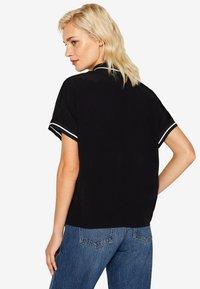 edc by Esprit - MIT ZIPPER - Poloshirt - black - 2