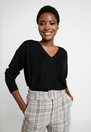 OCS LLT  - Stickad tröja - black