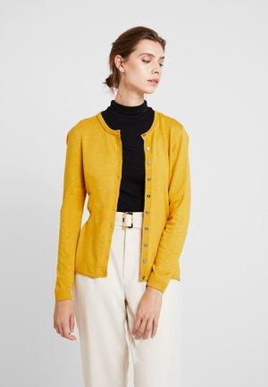 Neuletakki - brass yellow