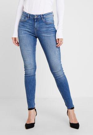 Skinny džíny - blue medium wash