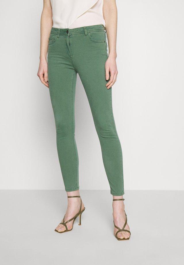 Jeansy Skinny Fit - khaki green