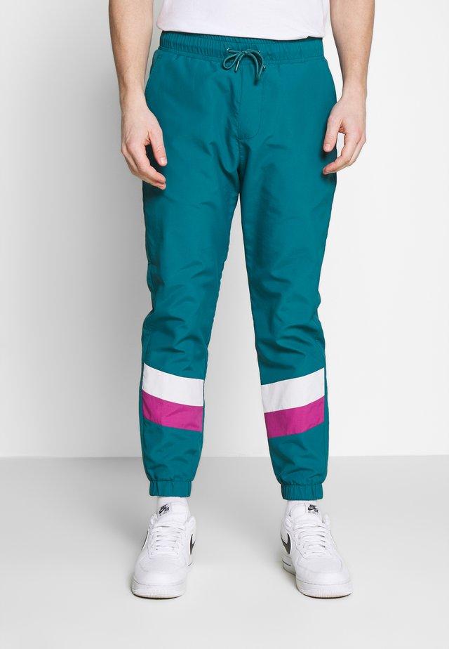 TRACK PANT - Pantalones deportivos - dark teal green