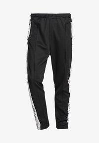 Edwin - TRAINING PANT - Pantalon de survêtement - black - 4