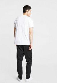 Edwin - TRAINING PANT - Pantalon de survêtement - black - 2