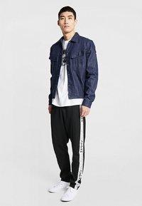 Edwin - TRAINING PANT - Pantalon de survêtement - black - 1