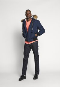 Edwin - REGULAR TAPERED - Straight leg jeans - dark blue denim - 1